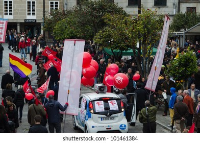 SPAIN - MAY 1: Groups of people demonstrated by Labor Day, where unions protest against the various social cuts approved by the Government of Spain, held on MAY 1, 2012 in Pontevedra, Spain.