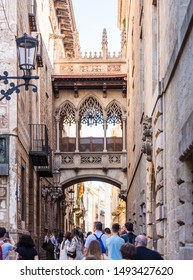 BARСELONA, SPAIN - MAY 31, 2019: Gothic Bridge On The Street Carrer Del Bisbe. Vertical