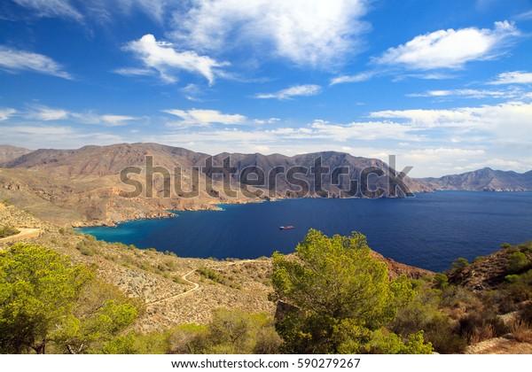 Spain Murcia mountains, blue sea and ship, Costa del Sol