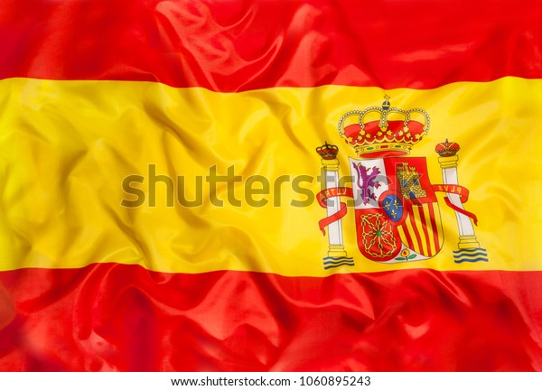 Spain national flag with waving fabric