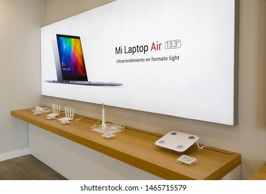 "Almería, Spain - October 11, 2018: Interior of a Xiaomi Mi Store, where the company sells smartphones, laptops and gadgets. The laptop sign reads ""Ultra performance in a light form factor"""