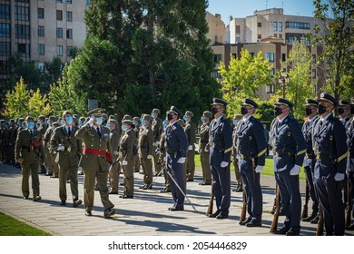 León, Spain - October 8, 2021: Act of raising the flag by the bodies and security forces of the state in the Plaza de San Marcos de León. Sergeants students of the Basic Air Academy
