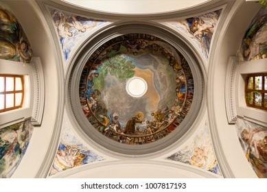 Spain Palma de Mallorca June 23, 2016: Palma de Mallorca, Spain, the ceiling of the church with the drawings of the saints. The ceiling of the church.