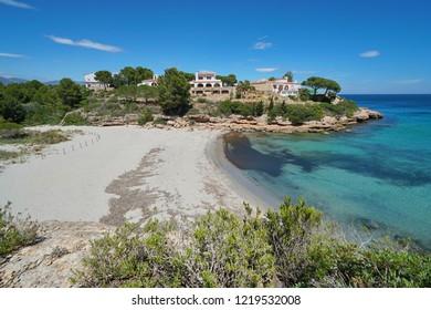 Spain peaceful sandy beach with coastal houses on the Costa Dorada, Cala Estany Tort, Mediterranean sea, Catalonia, L'Ametlla de Mar, Tarragona