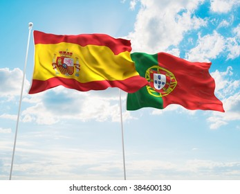 Spain & Portugal Flags are waving in the sky