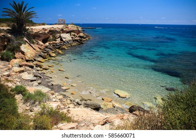 Spain, the rocky sea coast and a quiet bay with a beach