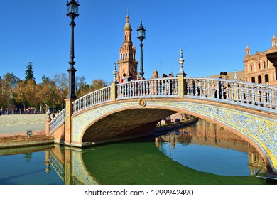 Spain, Seville, December 2018 view of the canal in Plaza de Espana in Seville, crossed by four bridges representing the four ancient kingdoms of Spain.