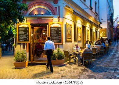 Spain, Seville, June, 12, 2018-Customers at Restaurant and Tapas Bar in Santa Cruz District