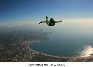 Spain. Skydiving men in Empuriabrava. Men fly above the city.