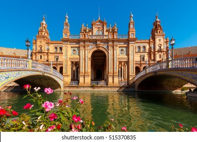 Spain Square or Plaza de Espana in Seville in the sunny summer day, Andalusia, Spain. Flower beds, bridges and channel in the foreground