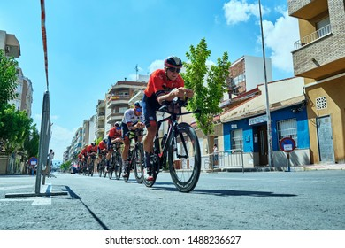 SPAIN, Torrevieja (Alicante) - AUGUST 24, 2019. Cyclists riding a first day race of La Vuelta 2019 competition.