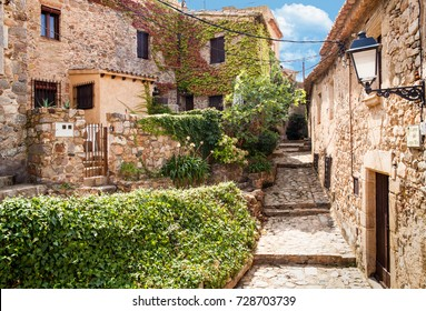 SPAIN, TOSSA DE MAR, 2017 ; Old town of Tossa de mar. Medieval buildings next to the castle. City and old fortifications. Narrow streets and monuments.