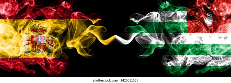 Spain vs Abkhazia, Abkhazian smoky mystic flags placed side by side. Thick colored silky smokes flag of Spanish and Abkhazia, Abkhazian
