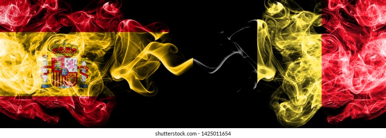 Spain vs Belgium, Belgian smoky mystic flags placed side by side. Thick colored silky smokes flag of Spanish and Belgium, Belgian