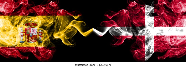 Spain vs Denmark, Danish smoky mystic flags placed side by side. Thick colored silky smokes flag of Spanish and Denmark, Danish