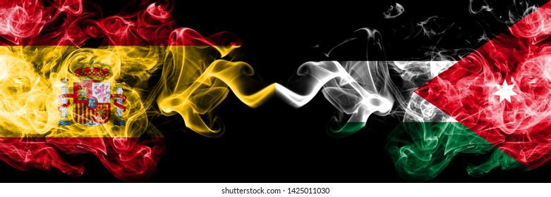 Spain vs Jordan, Jordanian smoky mystic flags placed side by side. Thick colored silky smokes flag of Spanish and Jordan, Jordanian
