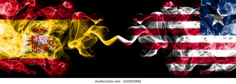 Spain vs Liberia, Liberian smoky mystic flags placed side by side. Thick colored silky smokes flag of Spanish and Liberia, Liberian