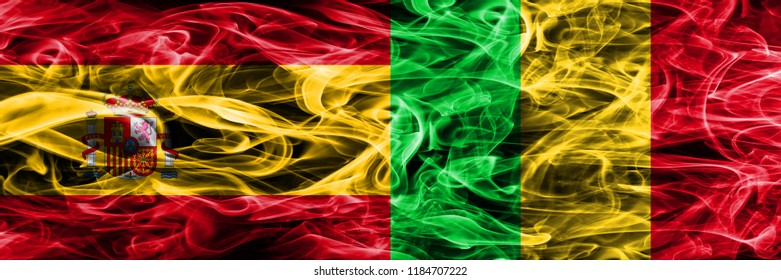 Spain vs Mali smoke flags placed side by side. Thick colored silky smoke flags of Spanish and Mali