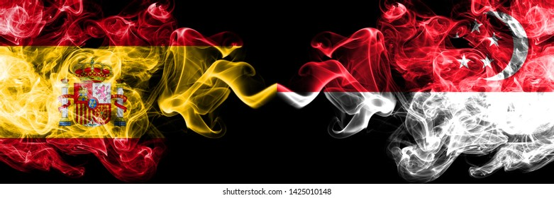 Spain vs Singapore, Singaporean smoky mystic flags placed side by side. Thick colored silky smokes flag of Spanish and Singapore, Singaporean