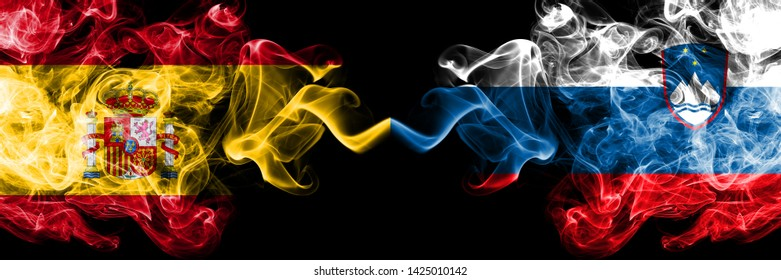 Spain vs Slovenia, Slovenian smoky mystic flags placed side by side. Thick colored silky smokes flag of Spanish and Slovenia, Slovenian