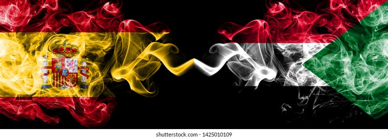 Spain vs Sudan, Sudanese smoky mystic flags placed side by side. Thick colored silky smokes flag of Spanish and Sudan, Sudanese