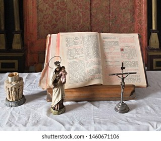 Spain,Badajoz,Don Benito 28.06.2019 Small private house altar with bible, cross and statue of Mary