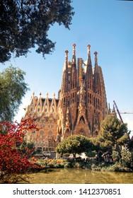SPAIN-Barselona- 19 March 2019- Sagrada Familia church with lake and tree view