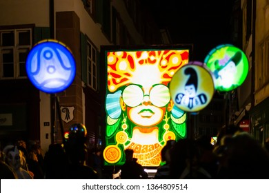 Spalenberg, Basel, Switzerland - March 11th, 2019. Close-up of a carnival group marching in the old town with their illuminated main and stick lanterns.