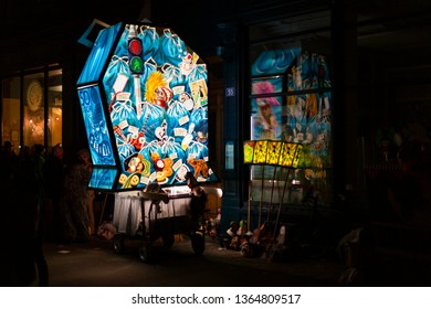 Spalenberg, Basel, Switzerland - March 11th, 2019. A single blue illuminated main lantern parked besides a restaurant.