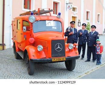SPALENE PORICI, CZECH REPUBLIC - JUNE 23, 2018: Firefighters truck veteran Mercedes-Benz with czech firemen in ceremonial uniforms. Firefighters exhibition for public.