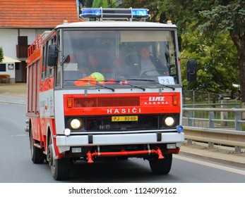 SPALENE PORICI, CZECH REPUBLIC - JUNE 23, 2018: Firefighters truck Liaz moving fast to the fire site. Firefighters exhibition for public.
