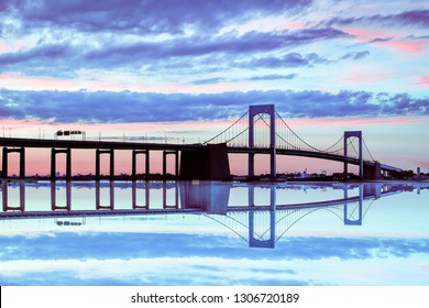 Span of the Throgs Neck Bridge in New York City colorful sky at dusk