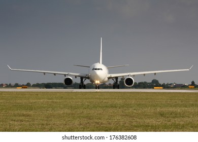 Span of white plane during line up runway