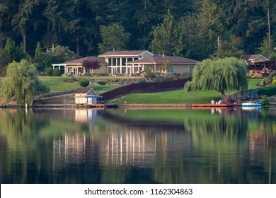 Spanaway Lake in Tacoma Washington in late summer with rich people's housing