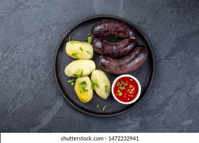 Spanish and Argentine MORCILLA blood sausages with potatoes and chile sauce