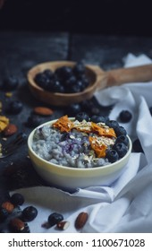 Spanish arroz con leche with blueberries and dried mango