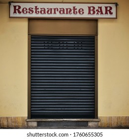 Spanish bar restaurant closed door.