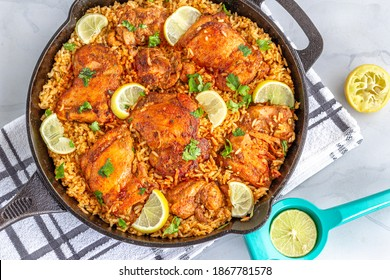 Spanish Chicken and Rice in a Skillet Directly Above Horizontal Photo