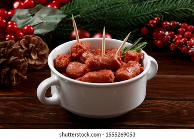 Spanish Chorizo Sausage with cocktail sticks and decorative background