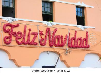 Spanish christmas decorations on a public building (feliz Navidad =  Merry Christmas in spanish)
