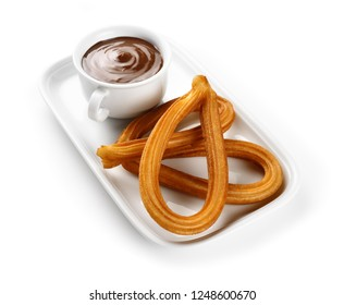 spanish churros with chocolate on white tray isolated