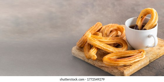 Spanish churros, fried-dough pastry served  usually with chocolate. Traditional breakfast everywhere in Spain. Large background for banner.Copy space