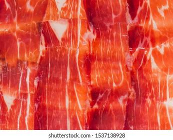 Spanish cured ham or Iberian Jamón background close up.