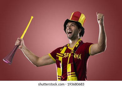 Spanish Fan Celebrating, on a red background.