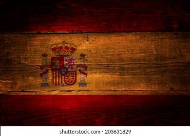Spanish flag. Spanish flag over a grunge wooden background.