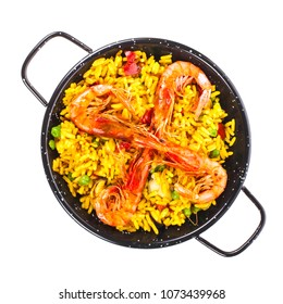 Spanish food - paella a small portion of paella in a typical skillet isolated on white background