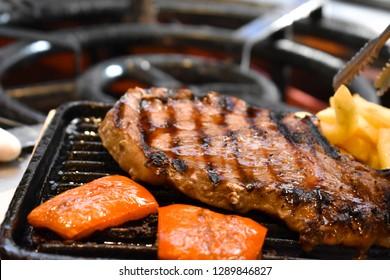 Spanish food steak cooking