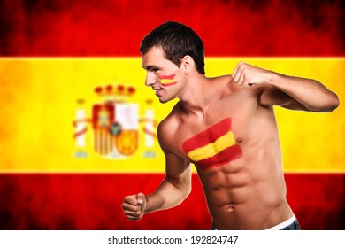 Spanish football fan is ready for fight over spanish flag background