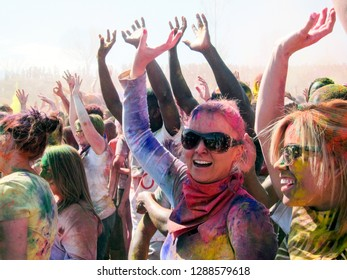 Spanish Fork, Utah / USA - 3/28/15 : Happy Crowd Dancing at the Holi Color Festival