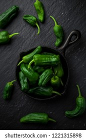 Spanish green peppers on frying pan
